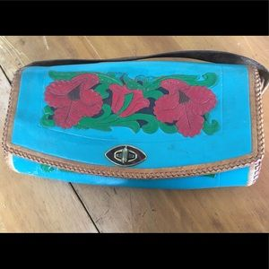 Hand tooled and painted leather purse never used